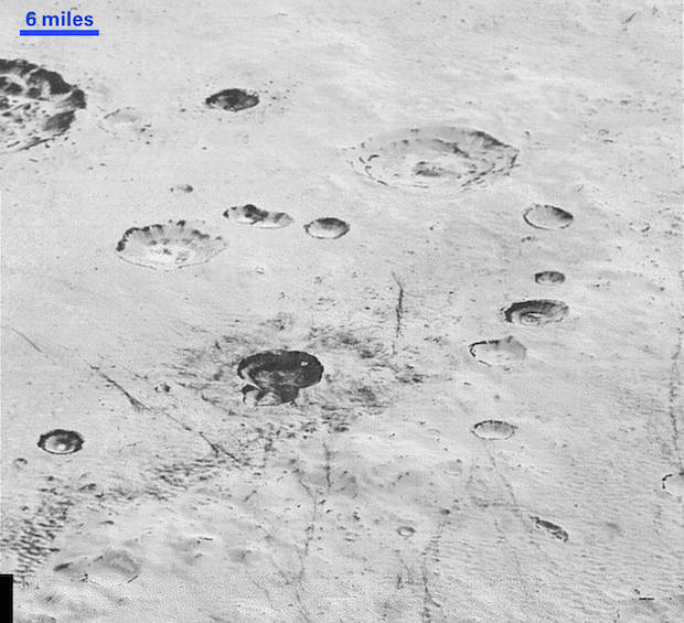 This highest-resolution image from NASA's New Horizons spacecraft reveals new details of Pluto's rugged, icy cratered plains, including layering in the interior walls of many craters. Credits: NASA/JHUAPL/SwRI