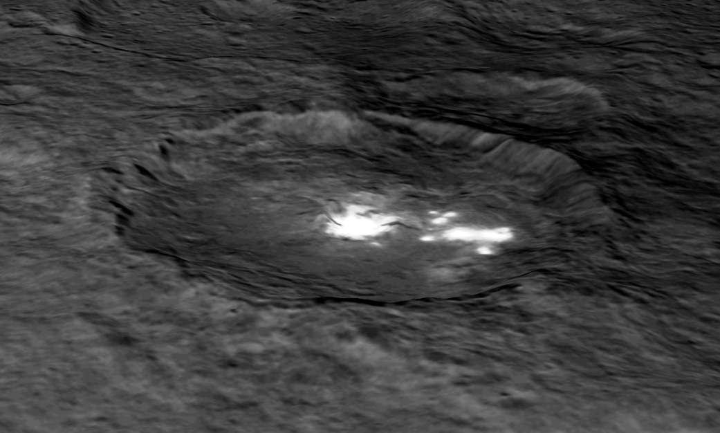 "An image of Occator Crater draped over a digital terrain model provides a 3-D-like perspective view of the impact structure. Several bright areas can be seen in this crater. The inner part of the crater forms a type of ""crater within a crater"" measuring about 6 miles (10 kilometers) in diameter and 0.3 miles (0.5 miles) in depth, and contains the brightest material on all of Ceres. Occator measures about 60 miles (90 kilometers) wide. Credit: NASA/JPL-Caltech/UCLA/MPS/DLR/IDA"