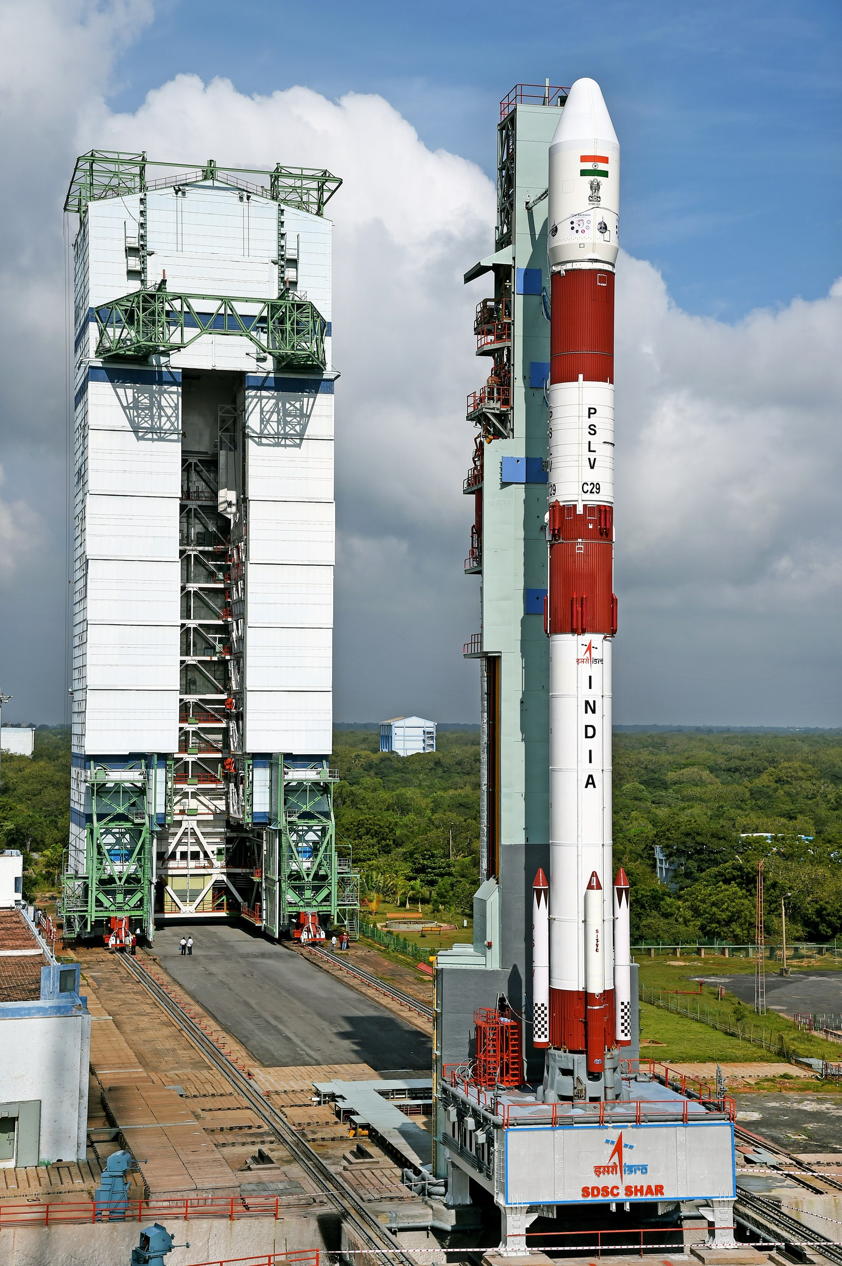 The Polar Satellite Launch Vehicle, topped by the TeLEOS 1 Earth observation satellite for Singapore, is seen during prelaunch preparations in India. Credit: ISRO