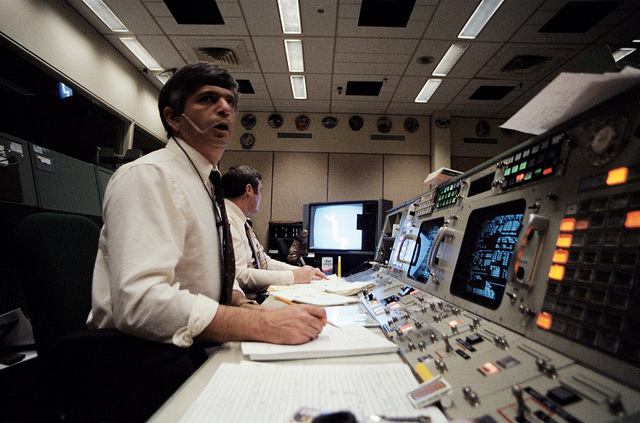 Challenger flight director Jay Greene (foreground) is pictured moments after the shuttle disintegrated. Credit: NASA