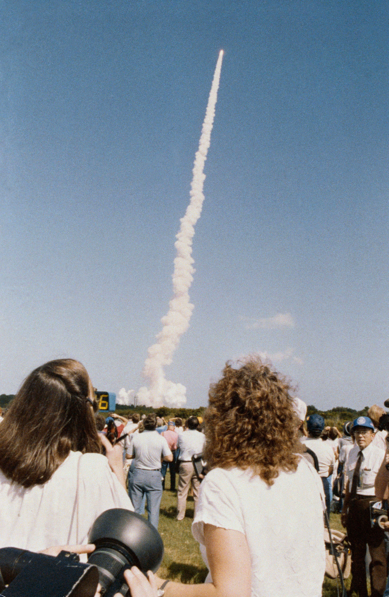 "Barbara Morgan and Christa McAuliffe, the backup and prime crew members for NASA's ""Teacher in Space"" program, view a shuttle launch in October 1985 from the Kennedy Space Center press site. Credit: NASA"