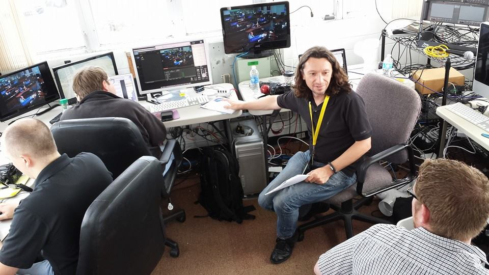 The Spaceflight Now team at work in December 2014 covering the EFT-1 mission from our Kennedy Space Center news bureau.