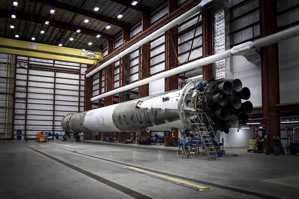 The Falcon 9 booster, fitted with nine Merlin 1D engines, is seen inside pad 39A's hangar at the Kennedy Space Center. Credit: SpaceX