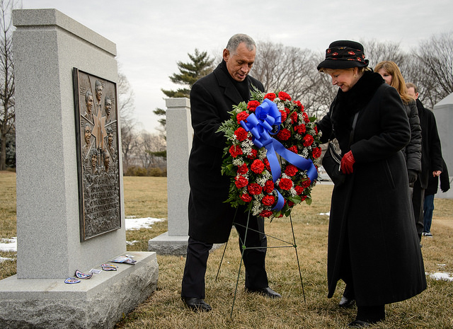 June Scobee Rodgers, widow of Challenger commander Dick Scobee, lays a wreath with NASA Administrator Charles Bolden at the Space Shuttle Challenger Memorial at Arlington National Cemetery in 2014. Credit: NASA/Bill Ingalls