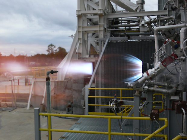 Blue Origin successfully test fires its BE-3 high-performance liquid hydrogen engine thrust chamber at NASA's Stennis Space Center in this 2012 file photo. Credit: NASA