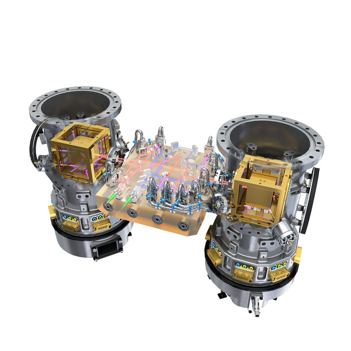 The two gold cubes, enclosed in vacuum containers (shown here without the launch lock mechanism), are key to the LISA Pathfinder mission. Each of these electrode containers houses a gold-platinum test mass. LISA Pathfinder will monitor the two cubes as they enter free-fall motion using a high-precision laser interferometer. Credit: ESA/ATG medialab