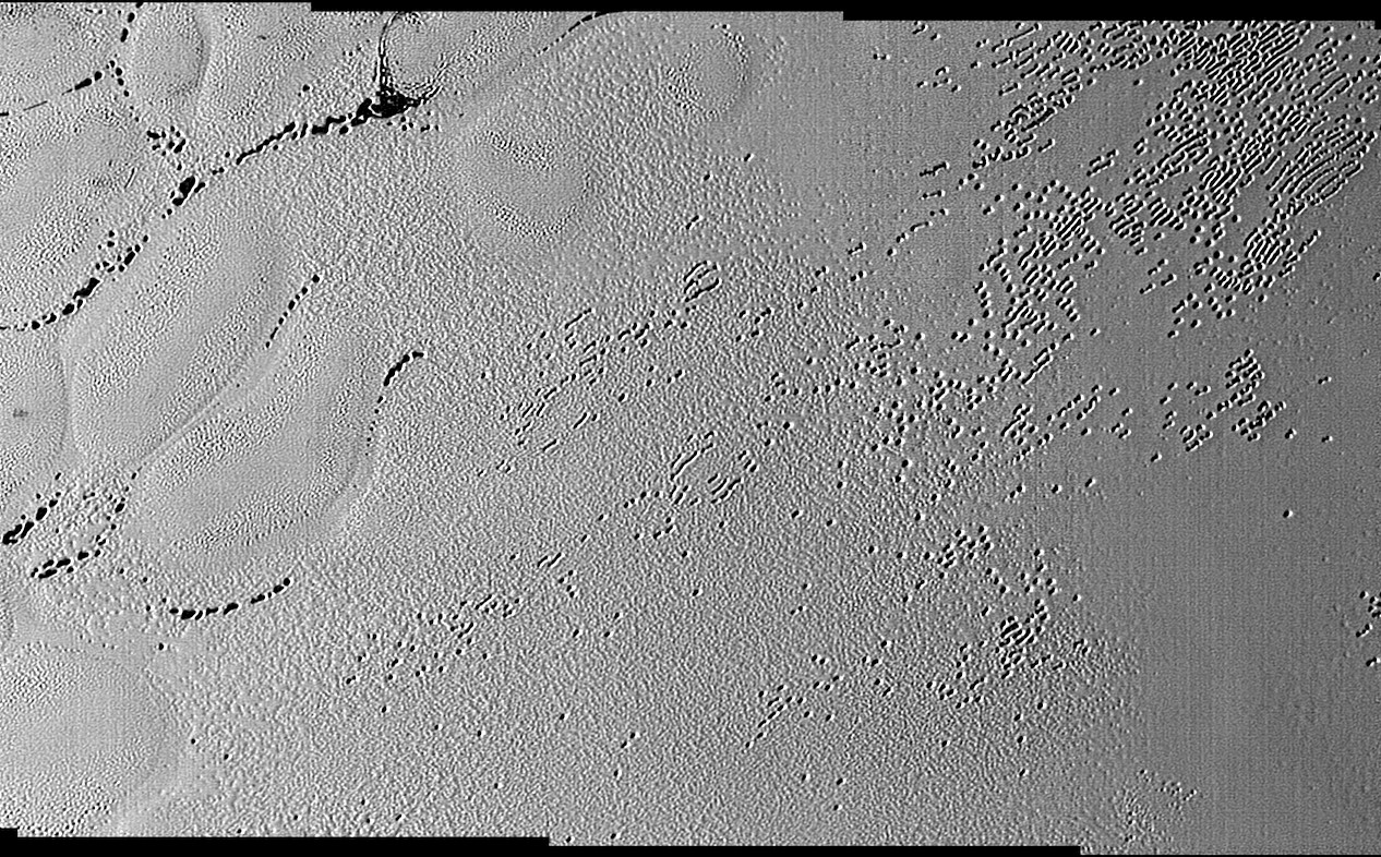This image was taken by the Long Range Reconnaissance Imager (LORRI) on NASA's New Horizons spacecraft shortly before closest approach to Pluto on July 14, 2015; it resolves details as small as 270 yards (250 meters). The scene shown is about 130 miles (210 kilometers) across. The sun illuminates the scene from the left, and north is to the upper left. Credits: NASA/JHUAPL/SwRI