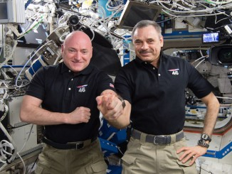 Mark Kelly, Scott's twin brother and a former shuttle astronaut, participated in the same physiological experiments on the ground, acting as a control in investigations into the effects of spaceflight on the human body. In this picture, Mark Kelly gives himself a flu shot. Credit: NASA