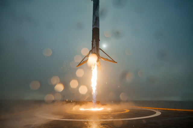 "A Falcon 9 first stage descends to an on-target touchdown on SpaceX's ocean landing platform after a liftoff from California on Jan. 24, but one of the booster's landing legs buckled, causing the vehicle to tip over. SpaceX is 0-for-3 on landing attempts aboard the offshore ""drone ship"" platforms, and 1-for-1 onshore. Credit: SpaceX"