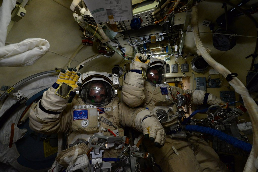 Cosmonauts Yuri Malenchenko and Sergey Volkov prepare for Wednesday's spacewalk. Credit: NASA/Scott Kelly