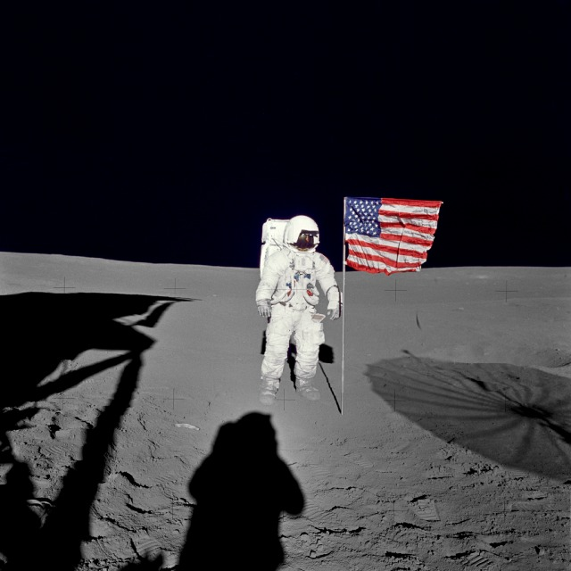 Astronaut Edgar D. Mitchell, lunar module pilot for the Apollo 14 lunar landing mission, stands by the deployed U.S. flag on the lunar surface during the early moments of the first extravehicular activity (EVA) of the mission. Credit: NASA