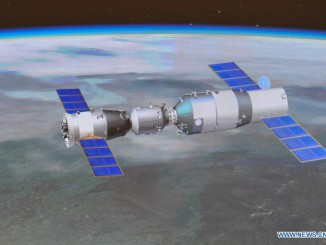 Artist's concept of a Shenzhou spacecraft (left) and the Tiangong 1 space lab module (right) in orbit. Credit: Xinhua