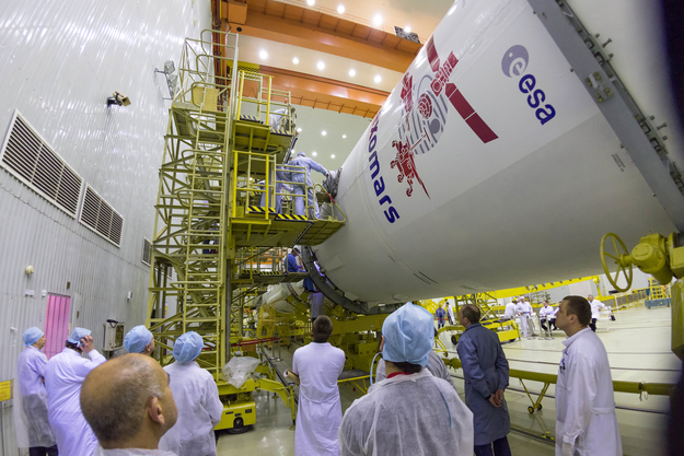 Ground crews attach the ExoMars spacecraft with the Proton rocket. Credit: ESA - B. Bethge