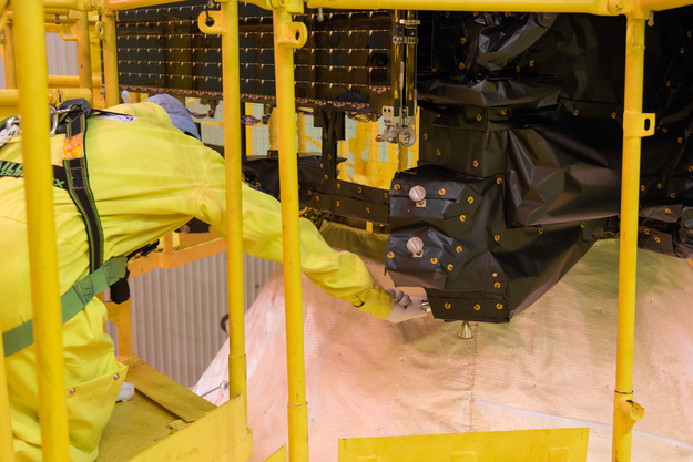 Protective covers are being removed from the thrusters on the Trace Gas Orbiter, before the spacecraft is encapsulated within the launcher fairing. Credit: ESA - B. Bethge