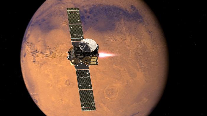 Artist's illustration of the ExoMars Trace Gas Orbiter firing its main engine to enter orbit around Mars. Credit: ESA/ATG medialab