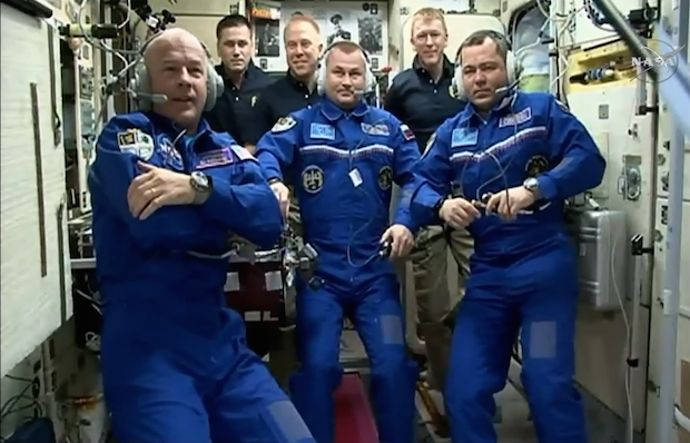 The six-person Expedition 47 crew during a welcome ceremony aboard the space station's Zvezda service module after docking. Credit: NASA TV/Spaceflight Now