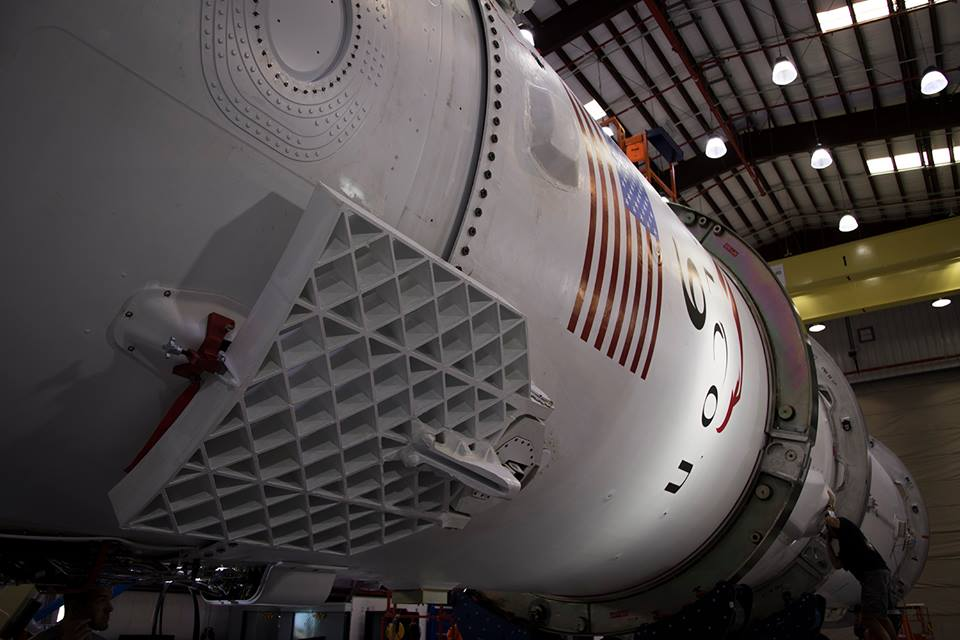 SpaceX's Falcon 9 rocket is pictured inside the hangar at Cape Canaveral's Complex 40 launch pad before rollout leading up to Tuesday's static fire test. Credit: SpaceX
