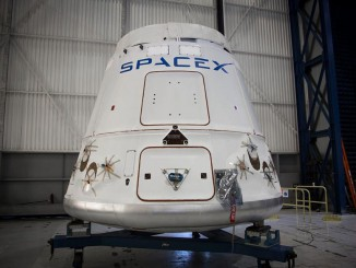 The Dragon spaceship set for liftoff Friday is pictured during launch preparations. Credit: SpaceX