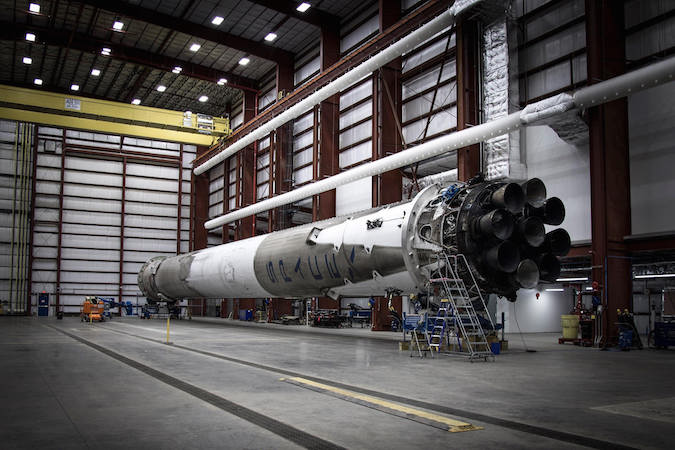 The Falcon 9 first stage booster recovered after a Dec. 21 launch at Cape Canaveral is seen inside SpaceX's hangar in Florida. Credit: SpaceX