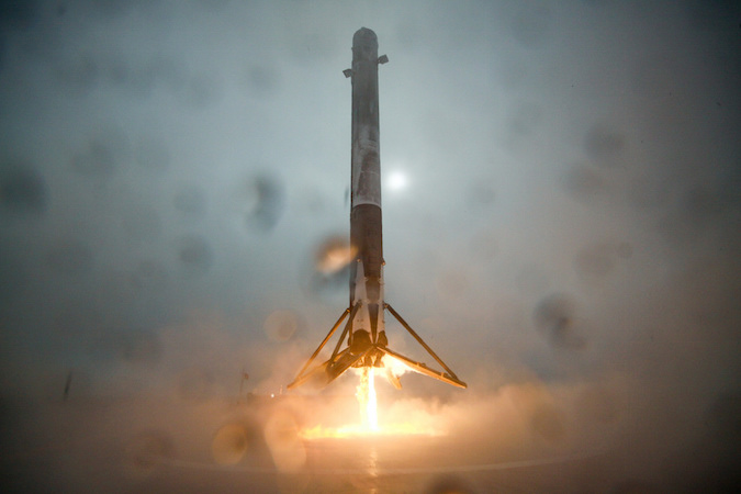 A Falcon 9 first stage descends to a crash landing on SpaceX's offshore recovery barge after a Jan. 17 launch from California. Credit: SpaceX