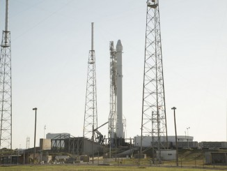 A Falcon 9 rocket sits on its launch pad this week awaiting liftoff Friday at 2043 GMT (4:43 p.m. EDT). Credit: SpaceX