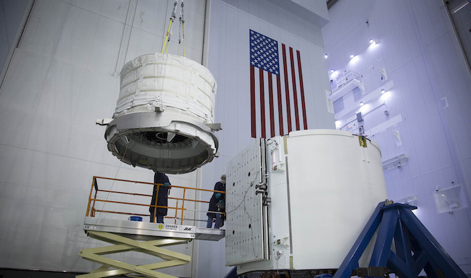 Technicians install the Bigelow Expandable Activity Module into the trunk of the Dragon spacecraft. Credit: SpaceX