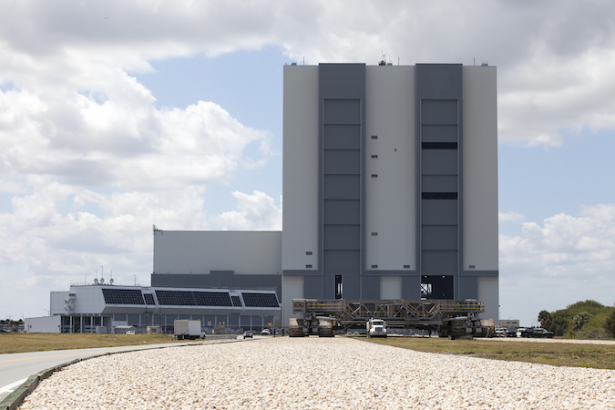 File photo of the Vehicle Assembly Building with a crawler-transporter in the foreground. Credit: NASA/Kim Shiflett