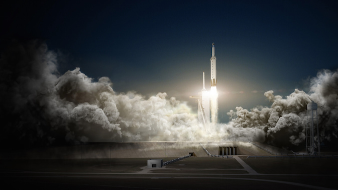 Artist's concept of the Falcon Heavy rocket blasting off with a Dragon spacecraft. Credit: SpaceX