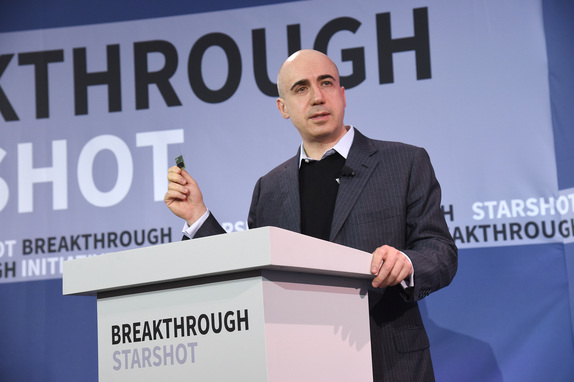 Entrepreneur Yuri Milner, holding up a prototype StarChip spacecraft he hopes to develop and, within a generation, launch to the nearest star using ground-based lasers and ultra-thin light sails. Credit: Breakthrough Starshot