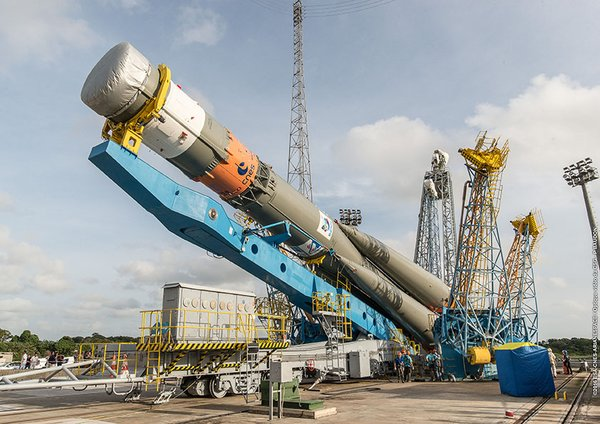 The Soyuz booster is lifted vertical Tuesday. Credit: ESA/CNES/Arianespace – Photo Optique Video du CSG – P. Baudon