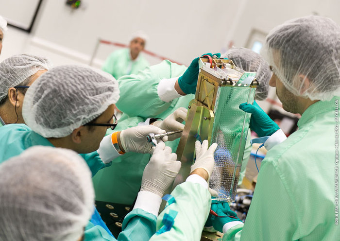 A student team works with the container holding the three ESA-sponsored CubeSats launched Monday. Credit: ESA/CNES/Arianespace – Photo Optique Video du CSG – JM Guillon