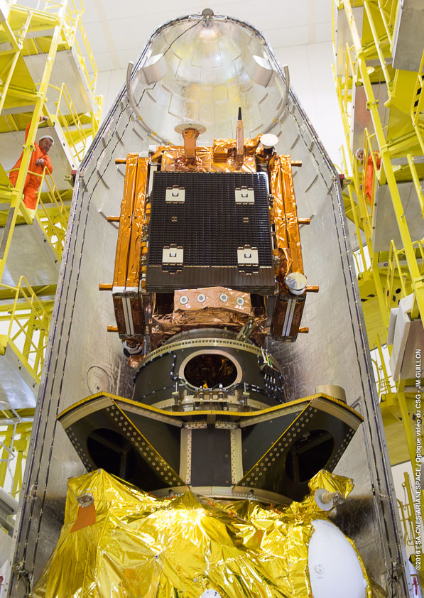 The Sentinel 1B satellite is seen mounted on top of the multi-payload stack before encapsulation inside the Soyuz rocket's payload fairing April 15. France's Microscope spacecraft is inside the multi-payload support structure below Sentinel 1B. Credit: ESA/CNES/Arianespace – Photo Optique Video du CSG – JM Guillon