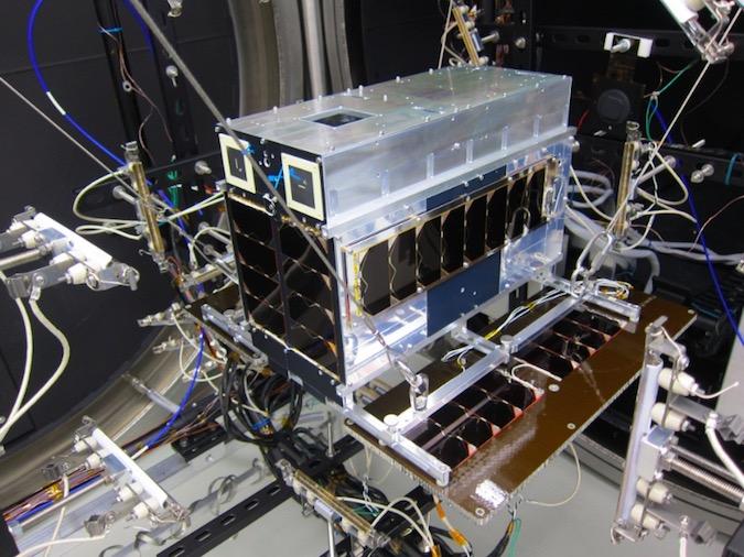 This picture shows the Norsat 1 satellite during thermal vacuum testing. Credit: UTIAS/SFL