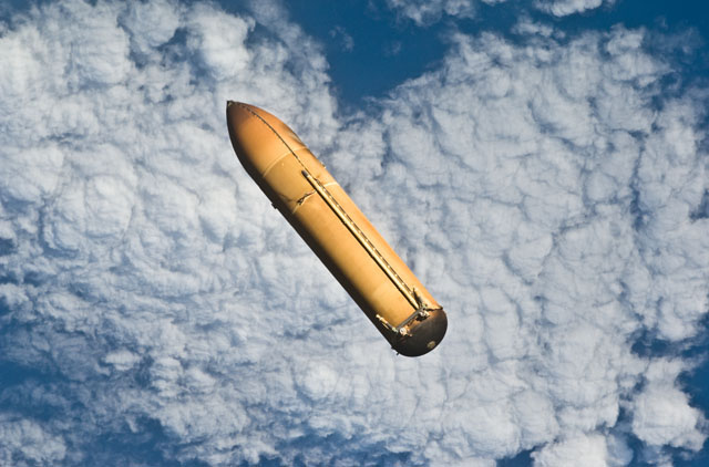 An external tank falls back to Earth after jettison. Credit: NASA