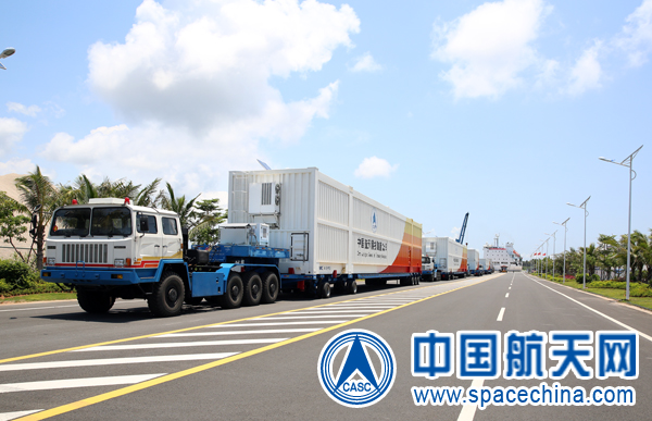 Trucks transport containers with Long March 7 rocket hardware from a port on Hainan Island to the Wenchang Satellite Launch Center last weekend. Credit: CASC