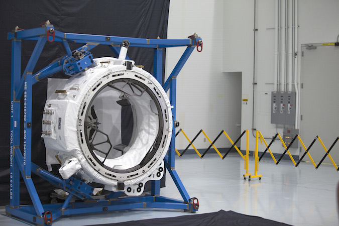 Photo of the second International Dockig Adapter awaiting launch at the Kennedy Space Center's Space Station Processing Facility. Credit: NASA/Charles Babir