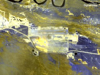 A shortwave infrared image captured by the WorldView 3 satellite shows a bright fire plume at Fort McMurray International Airport. Credit: DigitalGlobe