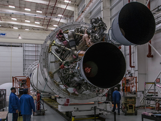 This wide-angle view inside Orbital ATK's Horizontal Integration Facility at Wallops shows Antares rocket hardware being readied for return-to-flight this summer. Credit: Mike Brainard/Orbital ATK