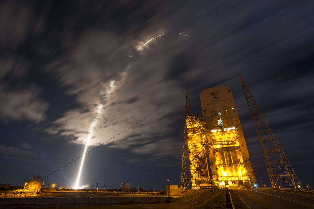 The most recent Atlas 5 arcs to orbit over the next Delta 4-Heavy rocket. Credit: ULA