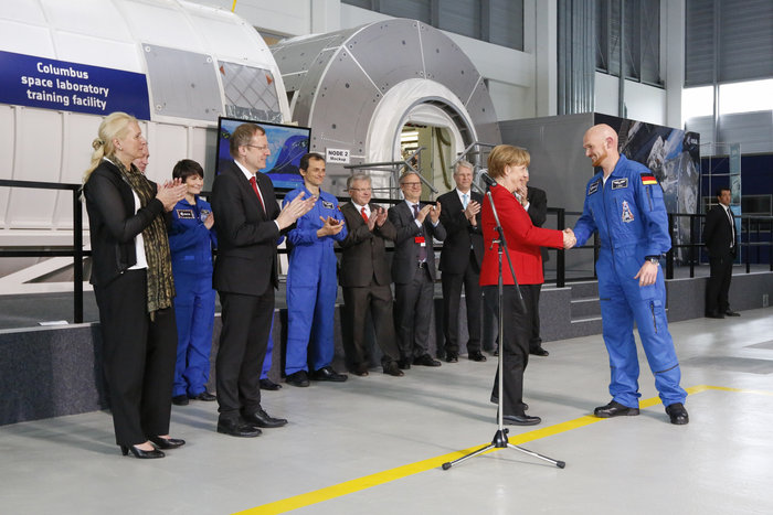 German Chancellor Angela Merkel congratulates astronaut Alexander Gerst on his selection as commander of the International Space Station's Expedition 58 crew. Credit: ESA/Grothues