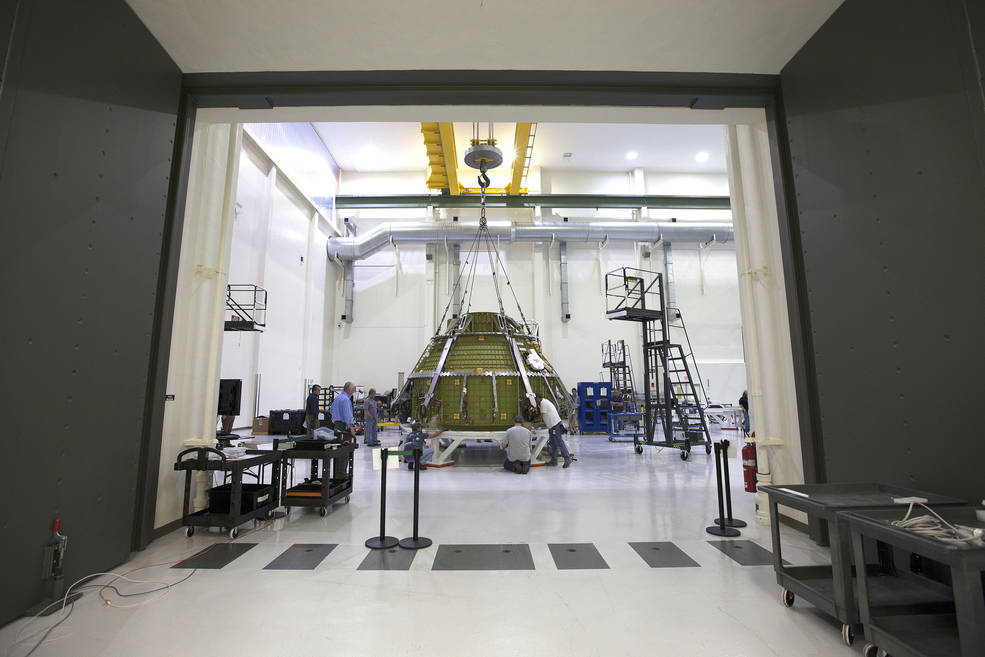 Lockheed Martin engineers and technicians prepare the Orion pressure vessel for a series of tests inside the proof pressure cell in the Neil Armstrong Operations and Checkout Building at NASA's Kennedy Space Center in Florida. This capsule will fly on Exploration Mission-1 in 2018. Photo credit: NASA/Kim Shiflett