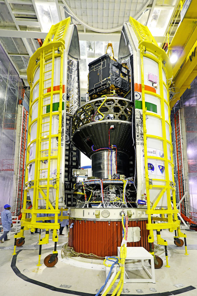 The 20 satellites are packaged inside the PSLV's payload fairing. The number marks the most satellites ever launched by India on a single flight. Credit: ISRO
