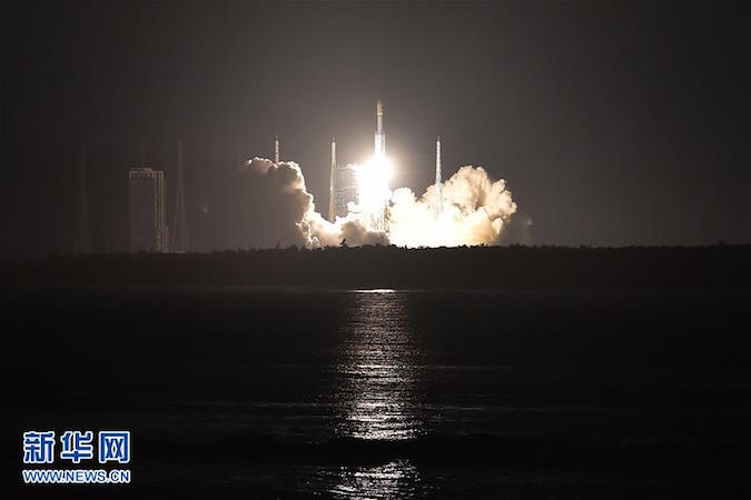 The Long March 7 rocket took off from a new launch pad at China's Wenchang space center. A launch facility for the even-larger Long March 5 rocket is visible to the left of the image. Credit: Xinhua