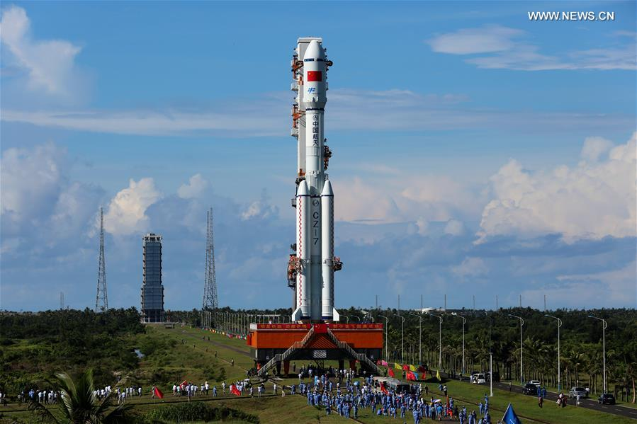 The Long March 7 rocket, standing 174 feet (53 meters) tall, emerged from its vertical assembly building to travel to a launch pad at the new Wenchang spaceport Wednesday. Credit: Xinhua