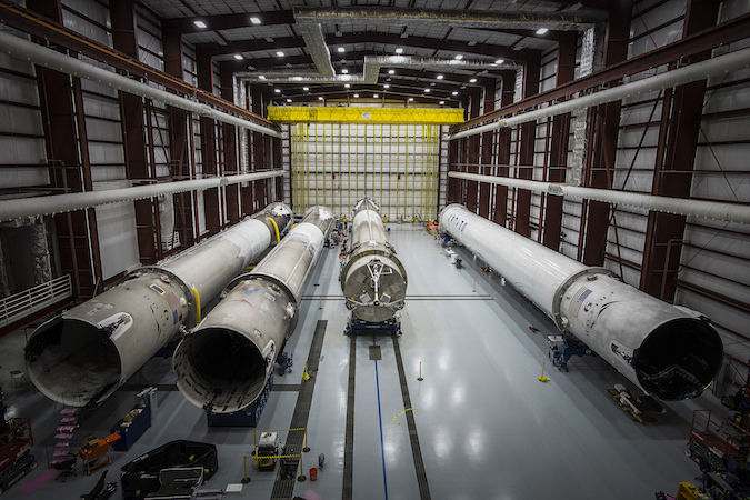 Four Falcon 9 rocket boosters are pictured inside SpaceX's hangar at launch pad 39A in Florida. Credit: SpaceX
