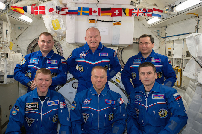 Russian cosmonauts Oleg Skripochka (top left), NASA astronaut Jeff Williams (top row middle) and Russian cosmonaut Alexey Ovchinin (top right) will stay on as crew members for Expedition 48. Peake, Kopra and Malenchenko are scheduled to come back to Earth on Saturday. Credit: NASA