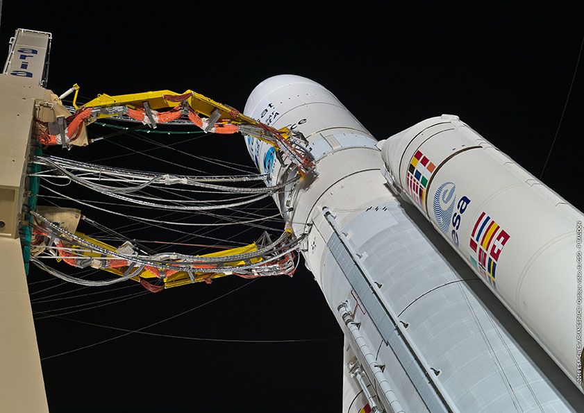 File photo of the cryogenic fueling arms attached to an Ariane 5 rocket before a launch earlier this year. Credit: ESA/CNES/Arianespace – Photo Optique Video du CSG – P. Baudon