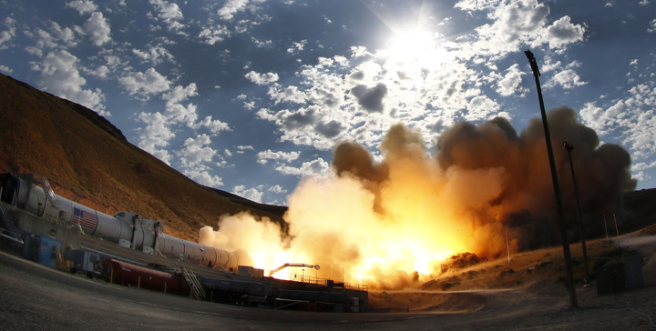 June 28,2016. Promontory UT. Raw fire power is blasted into a hillside as ATK test fires a solid rocket booster motor that burns 6 tons of propellant each second with expanding gases and flames exiting the nozzle at speeds in excess of Mach 3 and temperatures reaching 3,700 degrees Fahrenheit Tuesday. Orbital ATK test fire happen at 9:05am MT time and NASA will use measurements from more than 530 data channels to evaluate motor performance, acoustics, motor vibrations, nozzle modifications, insulation upgrades. Photo by Gene Blevins/LA DailyNews