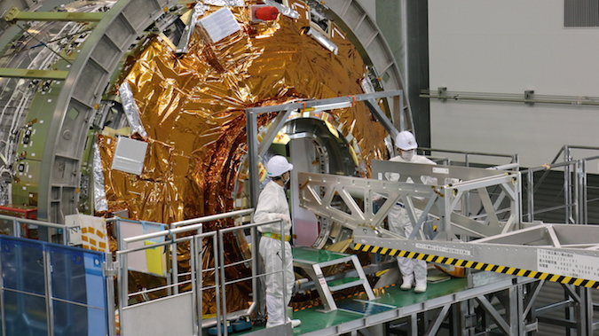 Technicians add cargo to the HTV 6 spacecraft's pressurized module at the Tanegashima Space Center. Credit: JAXA