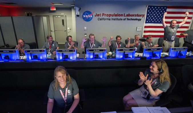 Members of the Juno team celebrate after confirming the spacecraft entered orbit around Jupiter on Monday. Credit: NASA/Aubrey Gemignani
